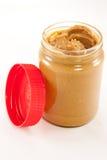 Tarro de mantequilla de cacahuete con la tapa Foto de archivo