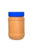 Tarro de mantequilla de cacahuete en blanco Fotos de archivo