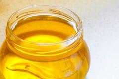 Tarro de miel floral orgánica imagenes de archivo