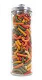 Tarro de pastas coloridas Imagen de archivo