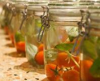 Tarro de tomates Imagen de archivo libre de regalías