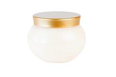 Tarro del casquillo de la crema y del oro Imagen de archivo libre de regalías