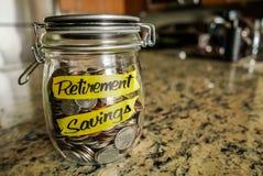 Tarro del dinero de los ahorros del retiro Fotografía de archivo