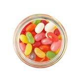 Tarro por completo de caramelos de la haba de jalea aislados Fotos de archivo libres de regalías