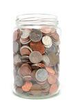 Tarro por completo de monedas Imagenes de archivo