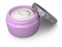 Tarro rosado de crema hidratante Foto de archivo libre de regalías