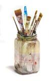 Tarro sucio viejo de cepillos de pintura Imágenes de archivo libres de regalías
