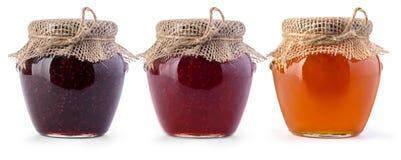 Tarro tres de atasco y de miel Foto de archivo libre de regalías