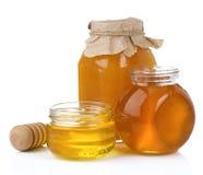 Tarro y crisol de cristal de miel con el palillo Foto de archivo libre de regalías
