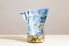 Tarro y dinero de cristal Imagen de archivo