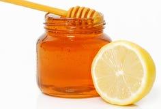 Tarro y limón de la miel aislados Fotografía de archivo libre de regalías