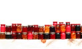 Tarros coloridos del jarabe Foto de archivo