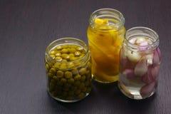Tarros con el alimento preservado Foto de archivo libre de regalías