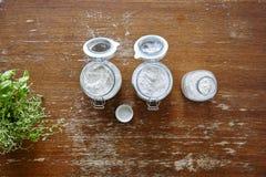 Tarros con las harinas en la tabla de madera Fotografía de archivo libre de regalías