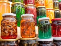 Tarros de cristal con los dulces Imágenes de archivo libres de regalías