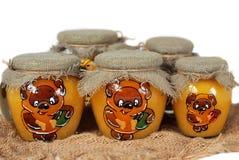 Tarros pintados de miel] Imagen de archivo