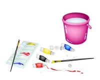 Tarros y paleta de la pintura del color con el cubo rosado Imágenes de archivo libres de regalías