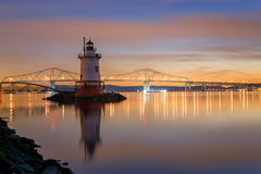Tarrytown Lighthouse and Tappan Zee Bridge. Sunset of Tappan Zee Bridge and Tarrytown Lighthouse reflecting in the Hudson River Stock Photography