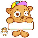 The Tarsier Mascot holding a big board with both hands. Animal C Royalty Free Stock Photography