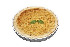 Tart. Baked leek tart with basil leaf on top-isolated royalty free stock photography