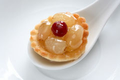 Tart. On the white spoon Royalty Free Stock Photography