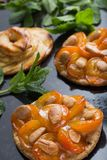 Tart with apricot and apple. Traditional french pie with fruits on dark marble background. Decorated almonds and mint Royalty Free Stock Images