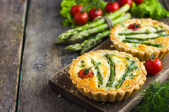 Tart with asparagus and cherry tomatoes Stock Photo