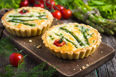 Tart with asparagus and cherry tomatoes Stock Image