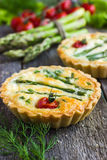 Tart with asparagus and cherry tomatoes Stock Photography