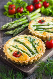 Tart with asparagus and cherry tomatoes Royalty Free Stock Photography