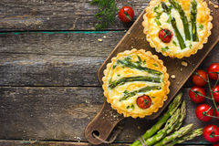 Tart with asparagus and cherry tomatoes Royalty Free Stock Image