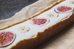 Tart with bananas and figs, close royalty free stock image