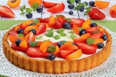 Tart beautifully topped with fresh fruits Stock Image