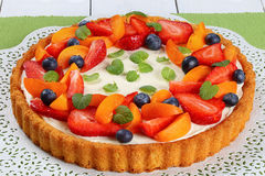 Tart beautifully topped with fresh fruits Royalty Free Stock Photo