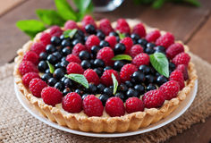 Tart with berries. And custard Royalty Free Stock Images