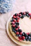 Tart with berries and custard Stock Photo