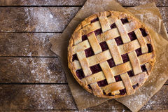 Tart with berries jam on wooden background Stock Photo