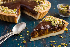 Tart with caramel, chocolate and nut Stock Photo