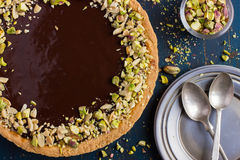 Tart with caramel, chocolate and nuts Stock Photos