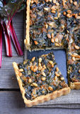Tart with chard and minced. On wooden table Stock Photography