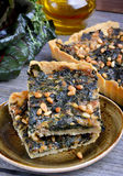 Tart with chard and minced. On wooden table Royalty Free Stock Image