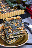 Tart with chard and minced. On wooden table Stock Photo