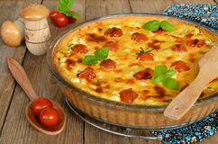 Tart with cheese and cherry tomatoes Stock Photography