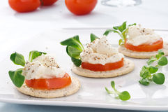 Tart with cheese, valerian and tomato Royalty Free Stock Images