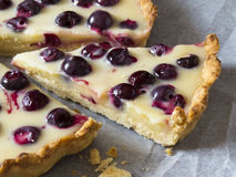 Tart with cherries and white chocolate cream. Open pie  from shortcrust pastry with  white chocolate cream  and cherries Stock Images