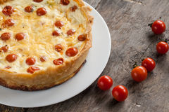 Tart with a cherry tomatoes and cheese Stock Images