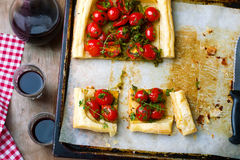 Tart with cherry tomatoes and herbs Stock Images