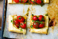 Tart with cherry tomatoes and herbs Stock Photo