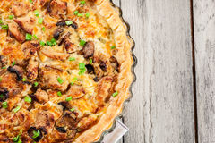 Tart with chicken, mushrooms and cheese Royalty Free Stock Image