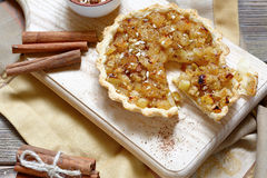 Tart with cinnamon  and apples on board. Tart with cinnamon and apples  on board, top view Royalty Free Stock Image